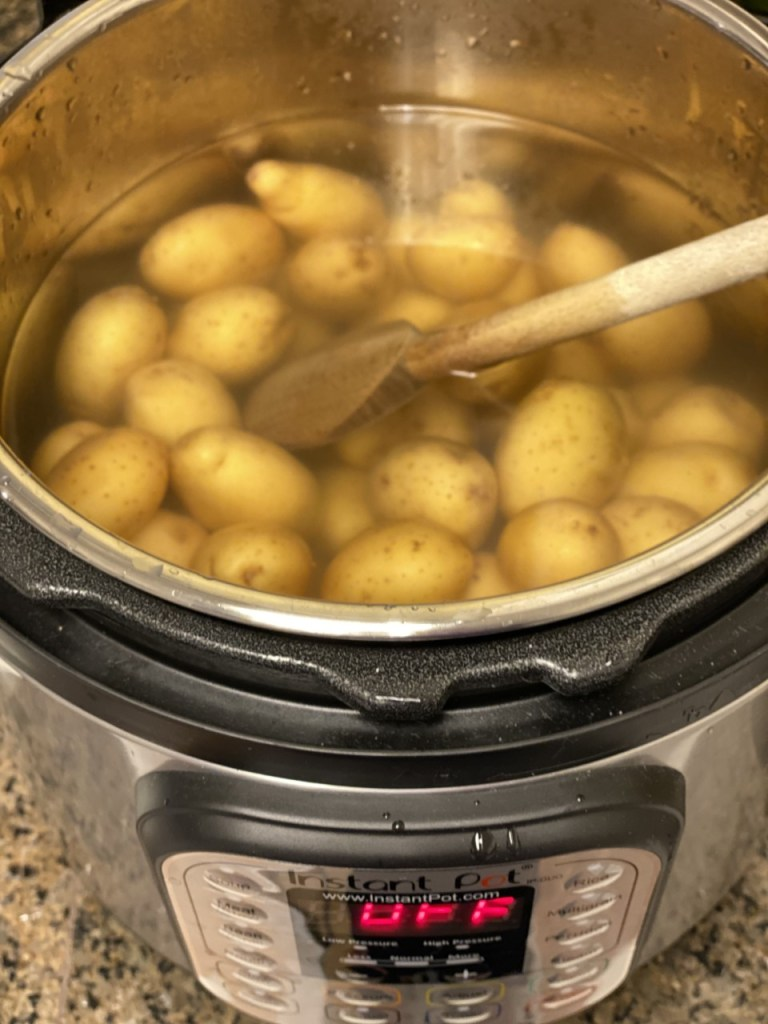 potatoes submerged in the salted water