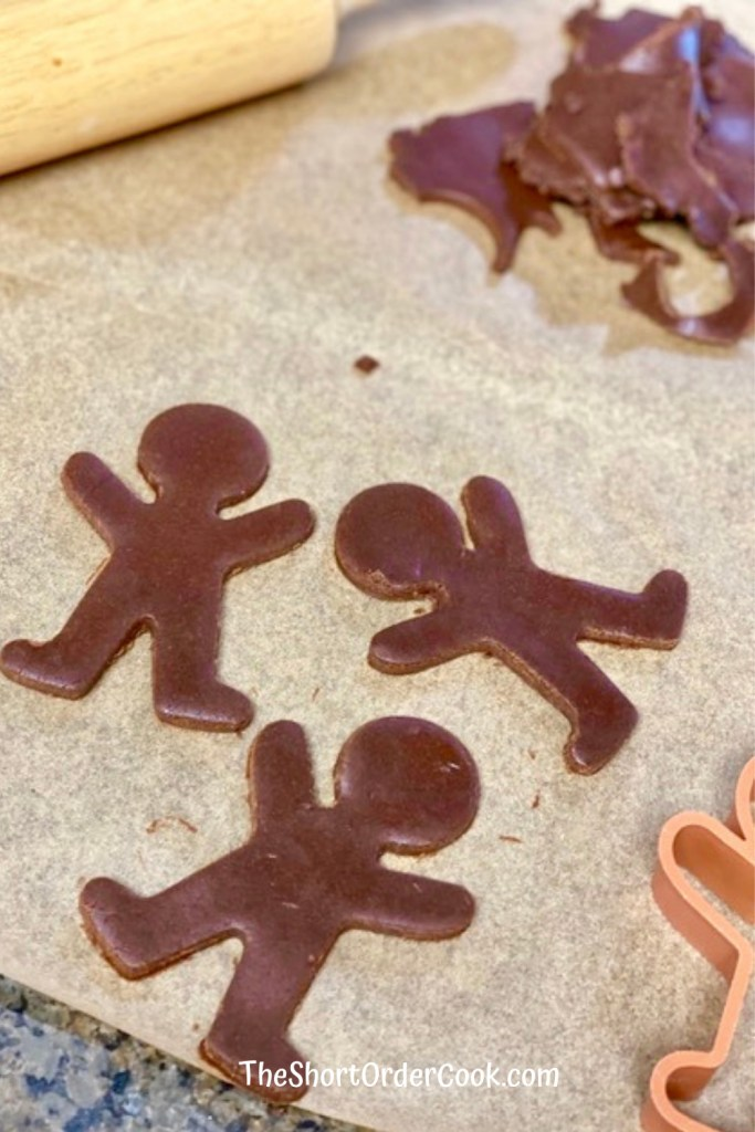 Chocolate Gingerbread Cookies rolled and cut into men