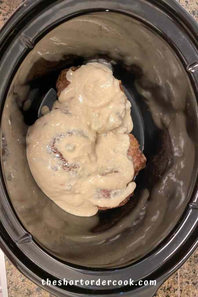 Slow Cooker Salisbury Steak stacking everything in the crock