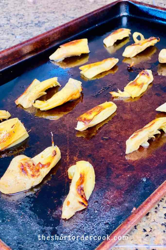 Crispy Baked Marinated Artichoke Hearts roasted on the sheet pan