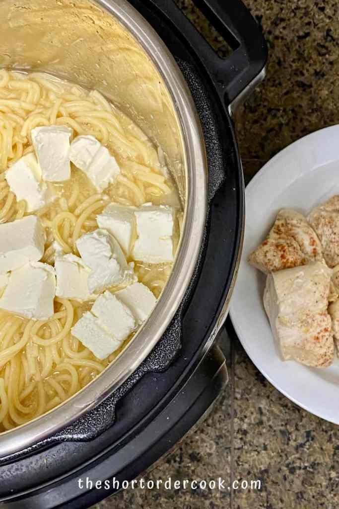 Instant Pot Creamy Chicken Spaghetti chicken done and add cream cheese