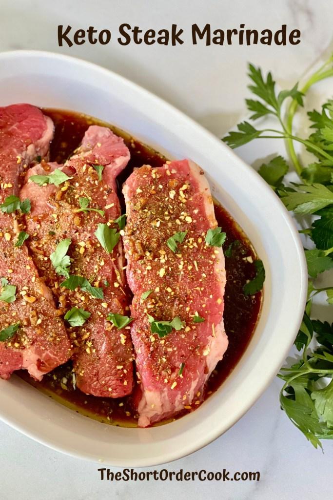 Keto Steak Marinade PN1 a dish of 3 steaks in a dark marinade