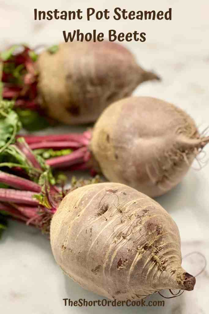 Instant Pot Steamed Whole Beets PN1 3 raw whole beets with beet greens still attached on the counter