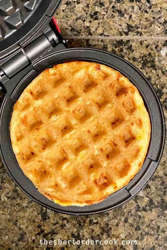 Keto Cornbread Chaffles overhead of one ready in the mini dash waffle maker