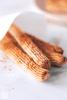What to Serve with Fajitas Keto-Churros-2-2 how2doketo 4 ready to eat churros with sprinkled cinnamon on white paper