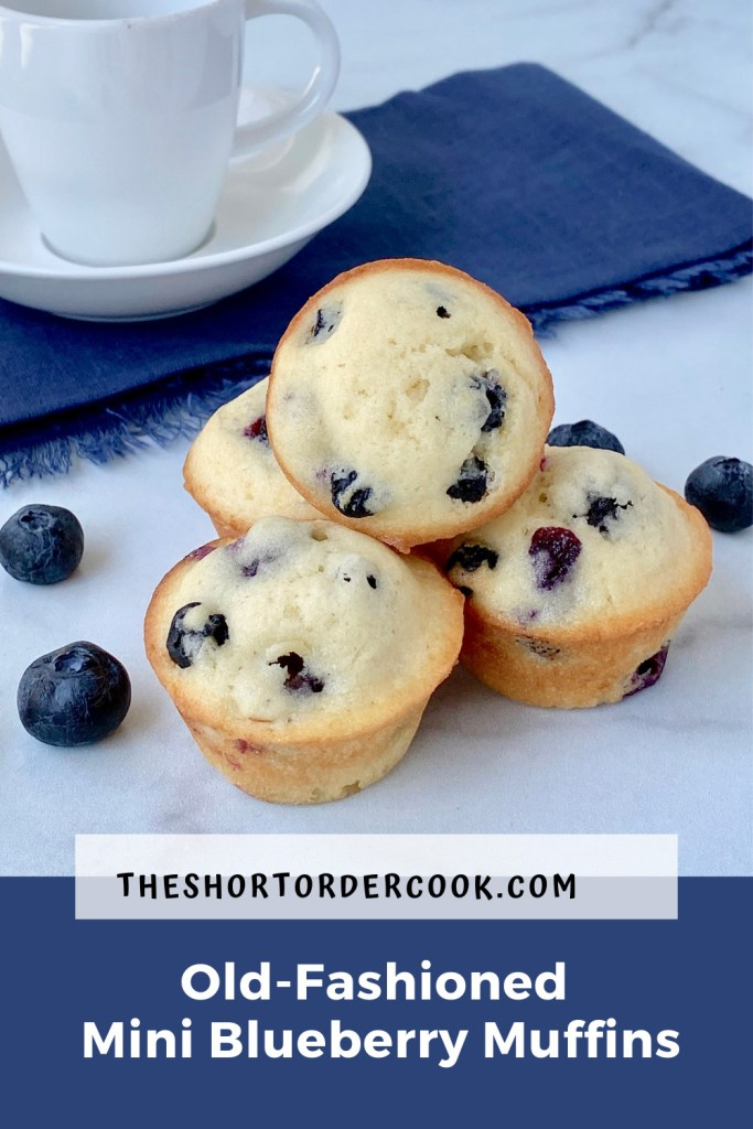 Old-Fashioned Mini Blueberry Muffins PIN four mini blueberry muffins on the counter with a blue cloth napkin and espresso cup in the background