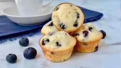 Old-Fashioned Mini Blueberry Muffins featured stack of muffins