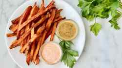 Deep Fried Sweet Potato Fries featured overhead of plate of fries and dipping sauce