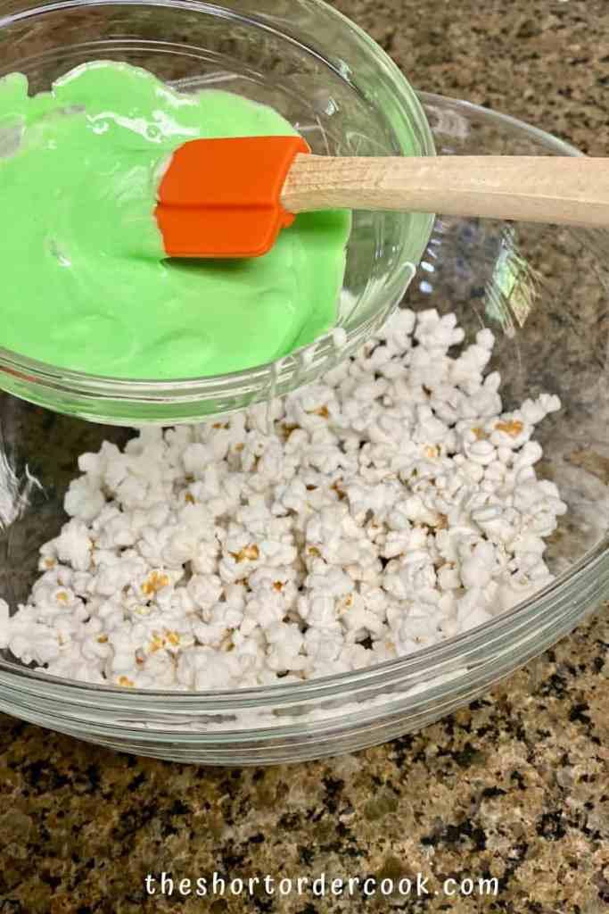Halloween Popcorn Balls add colored marshmallow mix to the popcorn