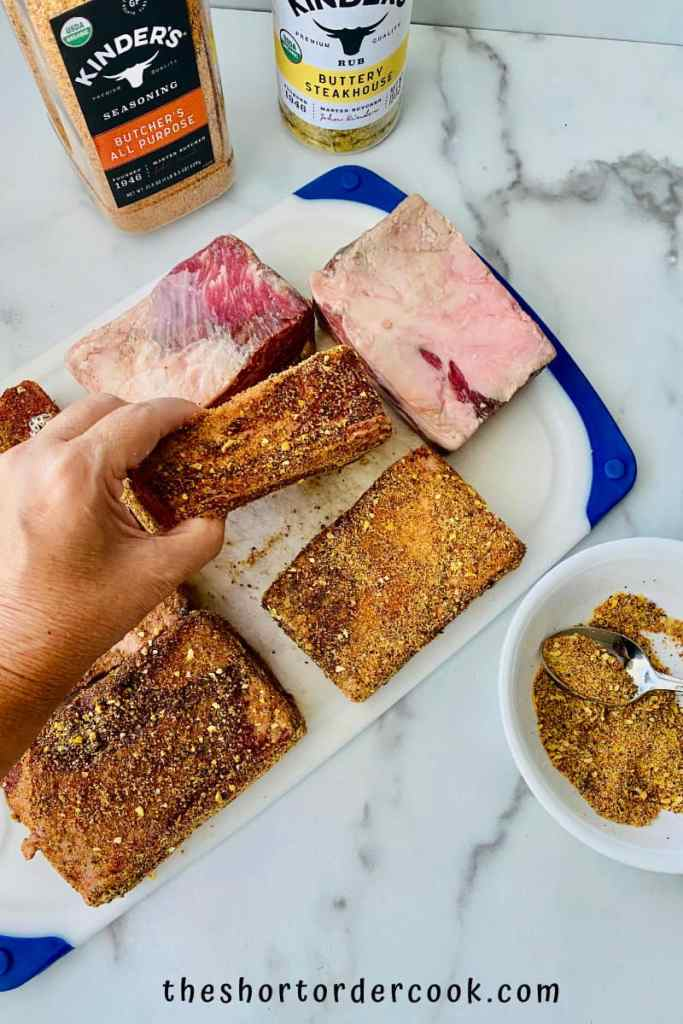 Smoked Beef Short Ribs applying the rub to the meat
