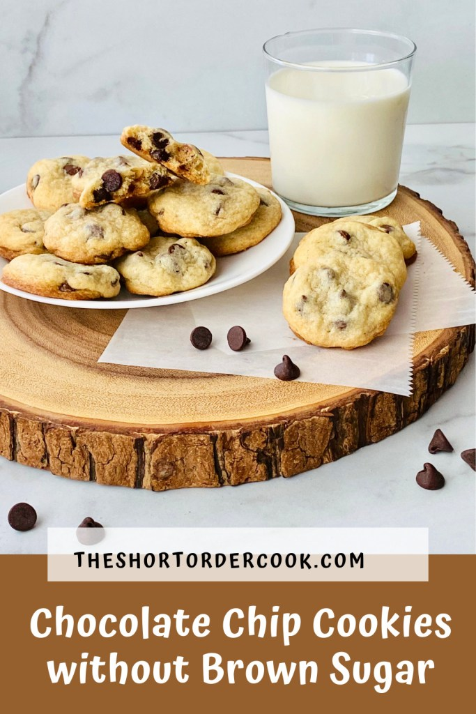 Chocolate Chip Cookies without Brown Sugar PIN a wood slab topped with a plate of cookies and a glass of milk