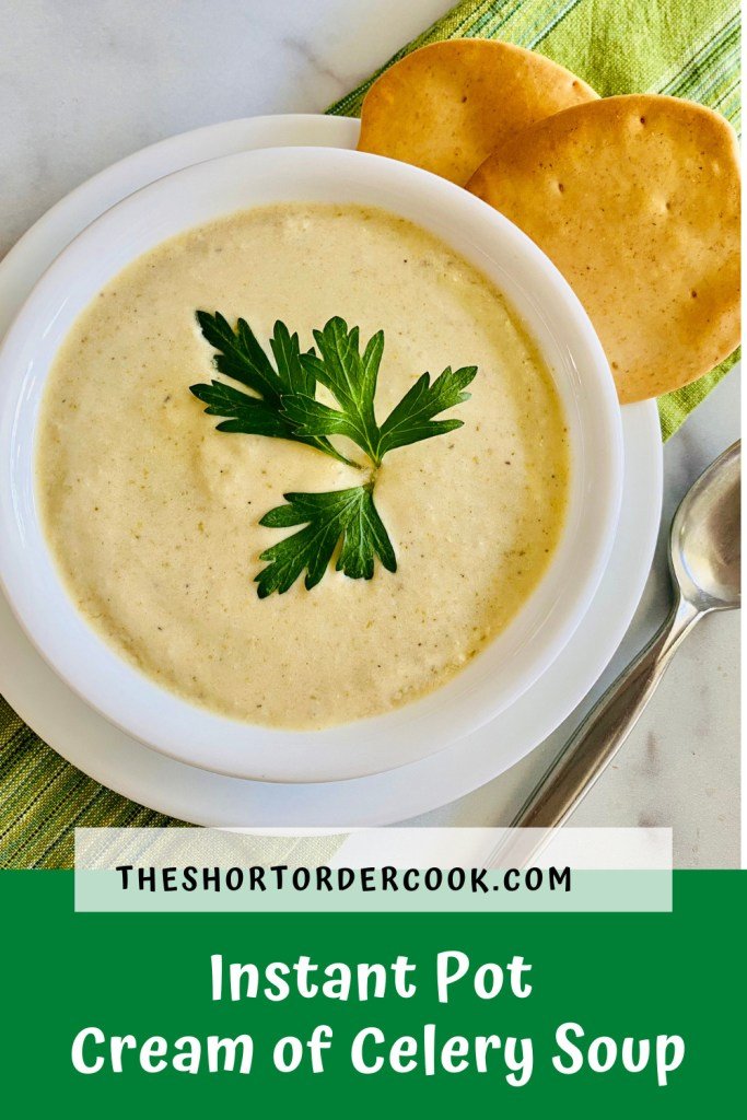 Instant Pot Cream of Celery Soup PIN bowl of soup ready to eat with crackers a spoon and green cloth napkin