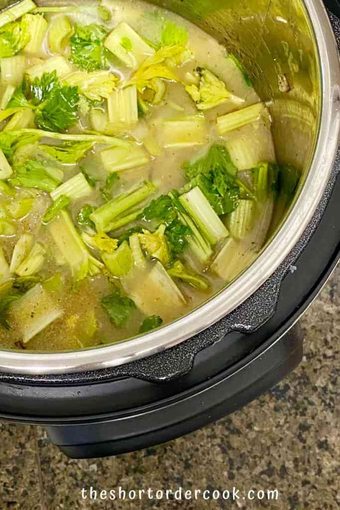 Instant Pot Cream of Celery Soup ingredients in the instant pot to cook