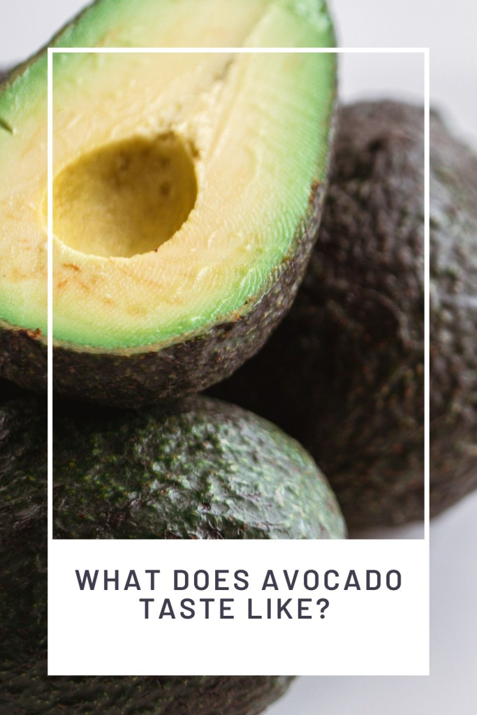 What Does Avocado Taste Like? PINREDO upclose of an avocado cut to reveal the light green flesh and pit is removed
