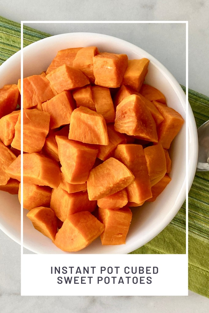 Instant Pot Cubed Sweet Potatoes PINREDO overhead picture of a bowl filled and a green cloth napkin and spoon