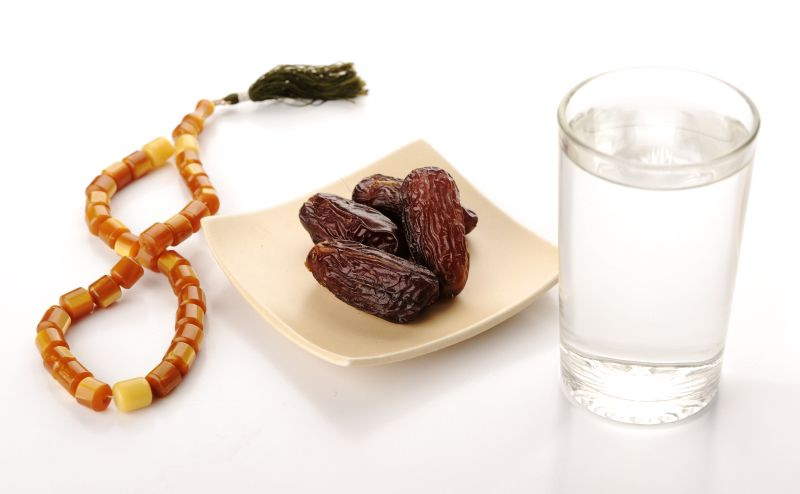 Prayer beads, figs and water image