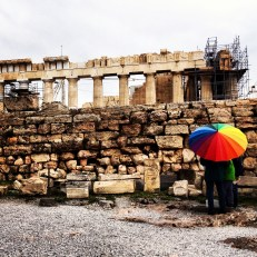 I love the contrast of the colourful umbrella against the brown tones of the ruins...
