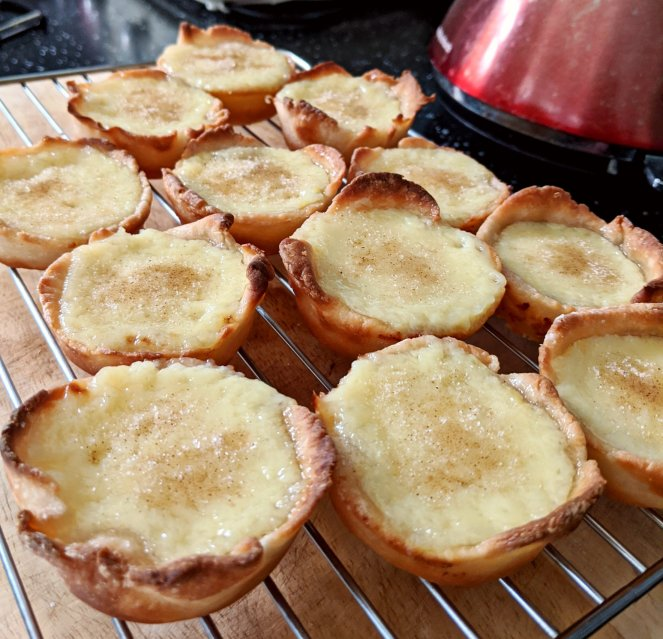 fresh from the oven portuguese custard tarts pasteis de nata belem the sickly mama blog cooling rack