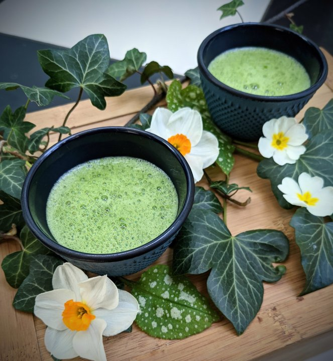 Two cups of ceremonial grade organic matcha made at home with the zen tea company