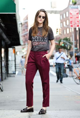 NEW YORK, NY - SEPTEMBER 03: Editor in Chief of Grandpa Style Ashley Owens is seen in Nolita wearing a vintage t-shirt, custom trousers with vintage shoes and Ray Ban sunglasses on September 3, 2014 in New York City. (Photo by Daniel Zuchnik/Getty Images)