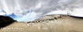 Morro Strand state beach with the sky covered by clouds. Morro Bay, CA