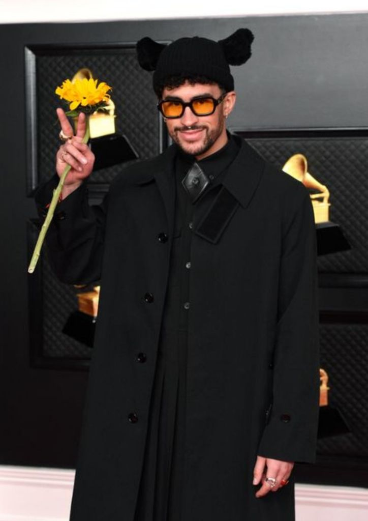Bad Bunny comes with a flower in hand as he celebrates being a Best Latin Pop Album Grammy nominee.