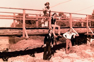 On the bridge standing - Mick. Ken is seated. Jon is standing on the left with Paul on the right