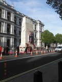 The Cenotaph is located in the centre of the wide thoroughfare of Whitehall