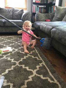 Avila and a broom