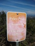 The trail marker from Cowles Mountain indicating Pyles Peak Trail.