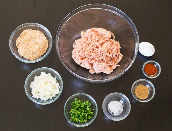 Ingredients for jalapeno chicken burger in glass bowls
