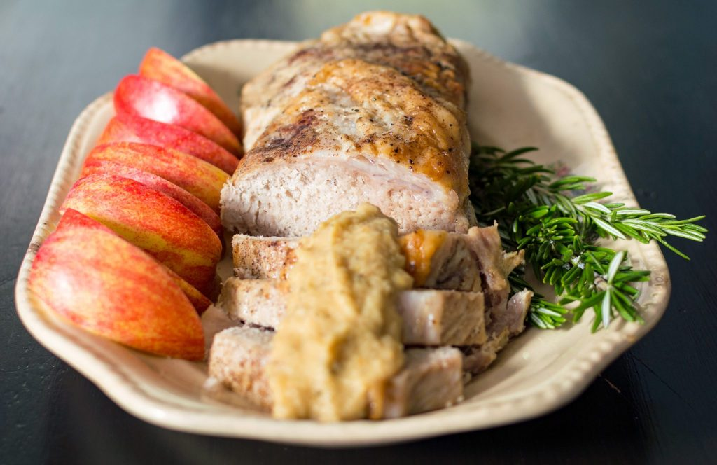 This crockpot pork loin with rosemary applesauce requires less than 30 minutes of hands on time making it an easy and delicious recipe for dinner any night. thesimplesupper.com
