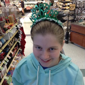 I don't have art for this part so here's a terrible picture of Johanna trying on festive headgear at the grocery store.