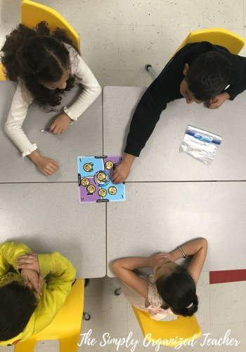 Students sharing and discussing with teammates using Kagan Cooperative Learning