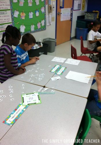 Picture in the classroom of students working together.