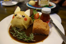 My dinner: Beef patty and mashed potatoes wrapped in a Pikachu crepe, with a side of tomato rice and a bottle of pikachu ketchup (which I got to keep!)