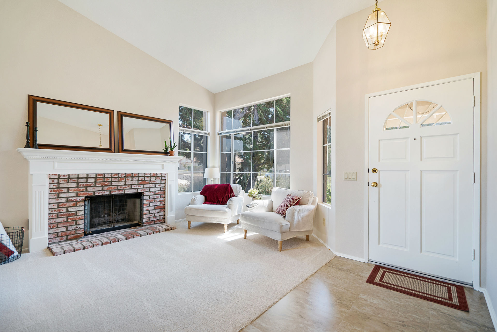 formal living room with brick fireplace paint my ideas tara april glatzel the sister team info for wood streets tile entry welcomes you to a vaulted ceiling and in new flooring