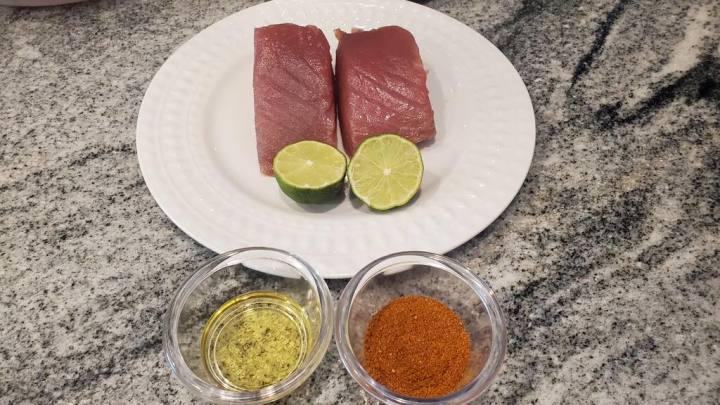 Seasoning tuna steaks