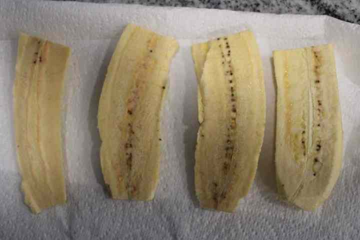 Cut each plantain in half then cut each half down the middle lengthwise.