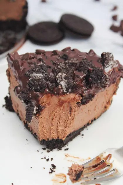 Creamy instant pot cheesecake with lots of chocolate and Oreos.