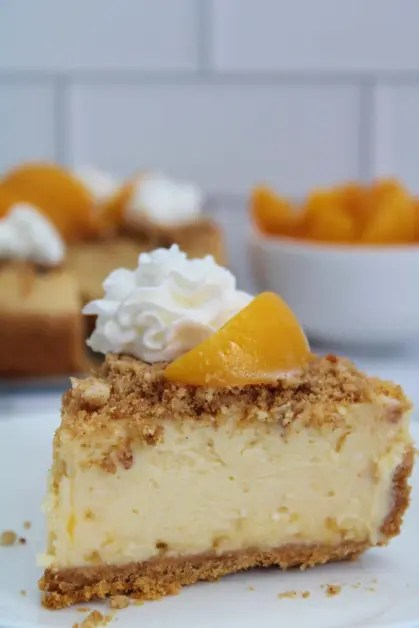 Easy cheesecake recipe with peach cobbler topping