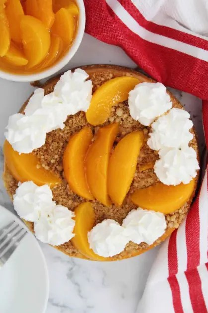 Instant pot peach cobbler cheesecake being served.