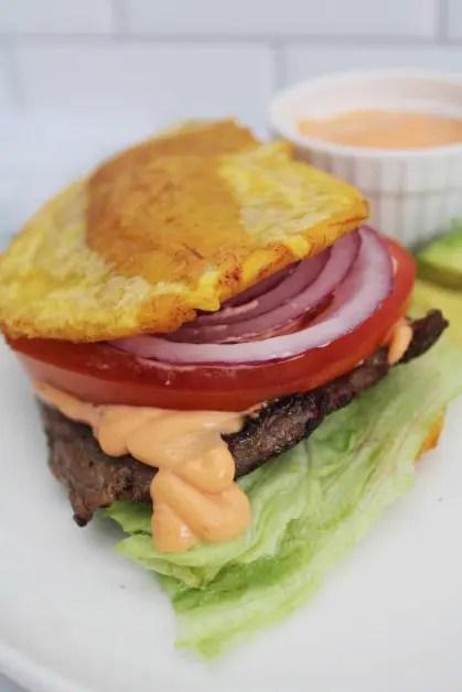 Serving a jibarito plantain sandwich.