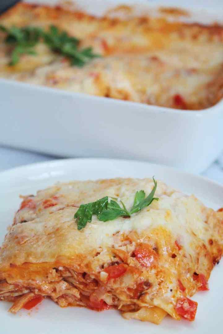 Serving a slice of chicken lasagna Brazilian style.