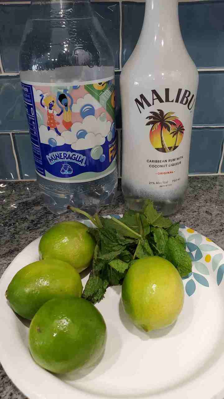 The ingredients to make coconut mojito are coconut rum, sparkling water, lime juice, mint leaves and sugar.