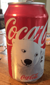 A can of Coke (12 fl ounces/355 ml) has 39 grams of carbohydrates (all from sugar, approximately 10 teaspoons),[47] 50 mg of sodium, 0 grams fat, 0 grams potassium, and 140 calories. Image courtesy of Gwyneth Pearson who likely consumed it