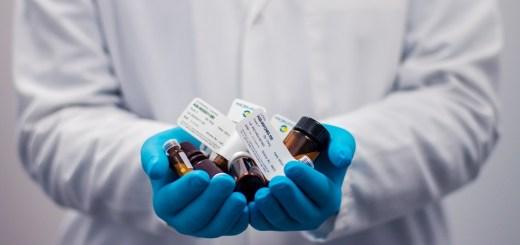 medicinal chemist holding drug candidates