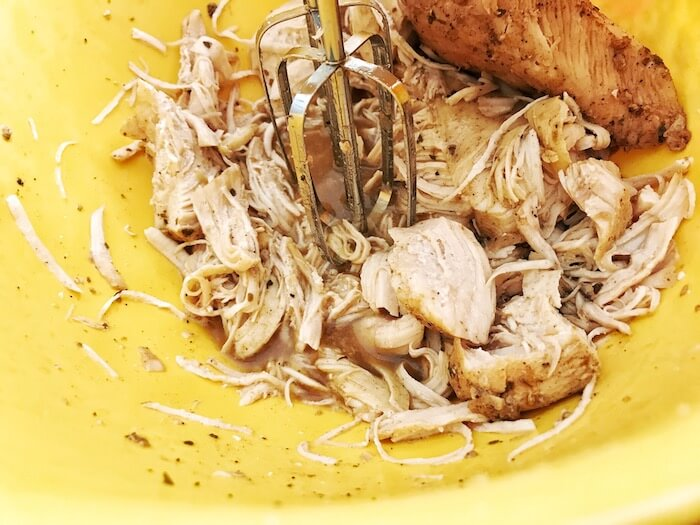 Instant Pot Shredded Chicken Chicken breast being shredded with a mixer