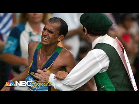 LOOK OUT! Rogue spectator tackles Olympic marathon leader in final miles (Athens 2004) | NBC Sports