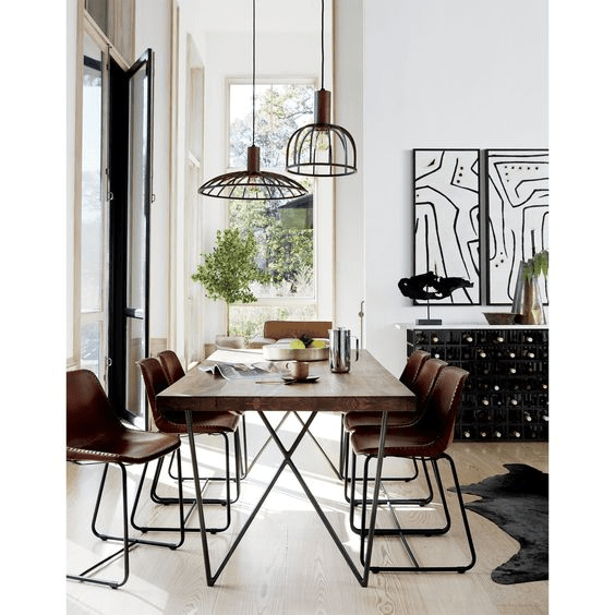 Geometric ceiling lamps over dining table